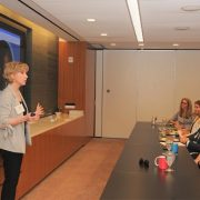 Carmie and attendees in a public speaking class