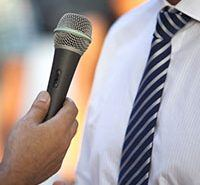 A media interview, man holding a mic