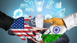 Handshake between an American hand and an indian hand